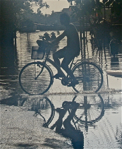 Cycling through Flood, Vietnam
